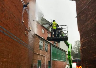 Pressure washing walls with high level access